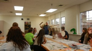 Mr. Brobeck explains to his students where to paint on their crates.