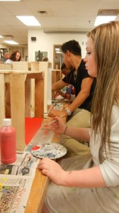 Students are taking great care in choosing their colors and painting a beautiful first coat.