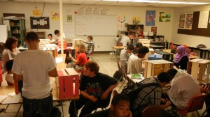 Students in Ms. Milazzo's class working to decorate their ofrendas.