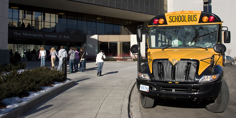 School Bus in front of the building